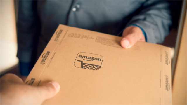 Person holding an Amazon package