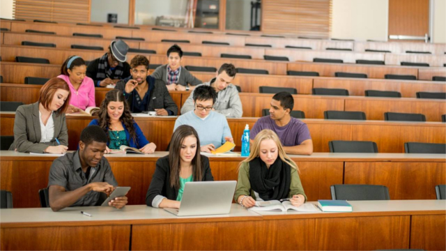 A group of students in a university classroom