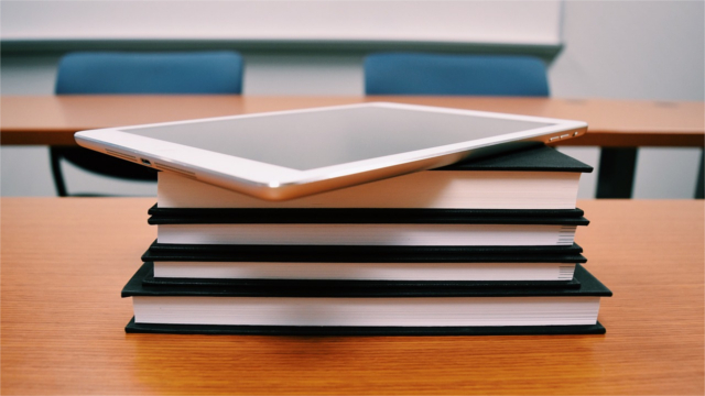 Tablet on a stack of books in a classroom