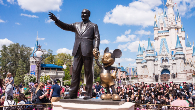 Walt Disney statue and Mickey Mouse statue at Disneyland in Orlando