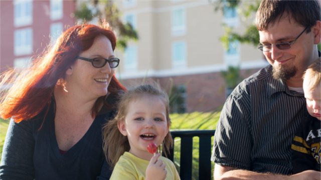 Heather Seuell with her husband and kids