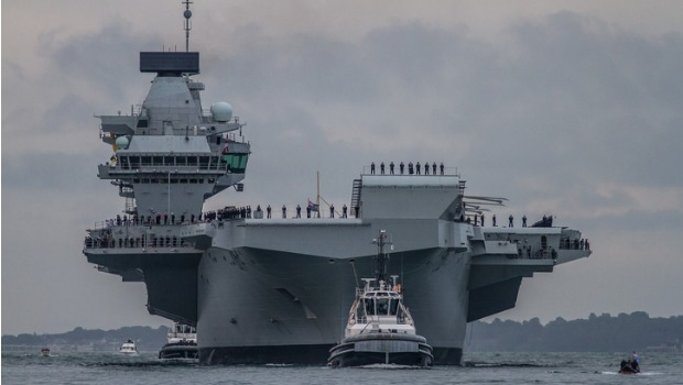 Two US Naval ships on water.