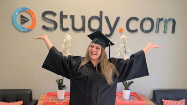 Working Scholar graduate celebrates in front of the Study.com logo